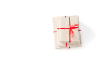 Parcel wrapped tied with red ribbon