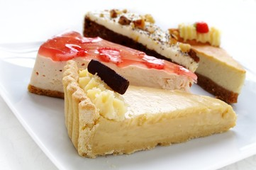 cheese cake selection on white platter