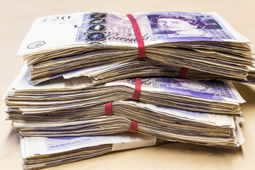 Pile of used UK 20 twenty pound notes