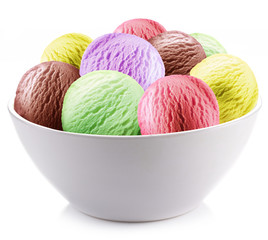 Colorful ice-cream balls in a white cup.