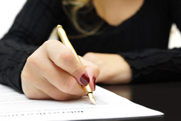 Woman is writing document