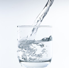 pouring water on a glass