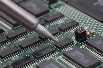 Soldering iron on circuit board