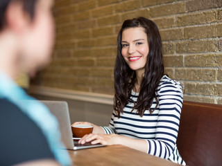 Attractive Woman Sitting With Laptop At Table