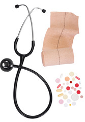 Close-up of pills with a stethoscope and a bandage