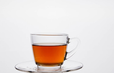 Glass cup of  tea. Isolated on white background