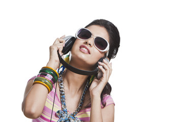 Beautiful young woman listening to music on headphones