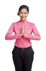 Portrait of a female customer service representative making greeting gesture