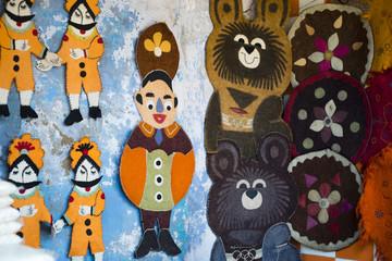 Close-up of decorative wall hangings for sale at Pushkar Camel Fair, Pushkar, Ajmer, Rajasthan, India