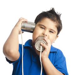 Close-up of a boy calling into a tin can phone