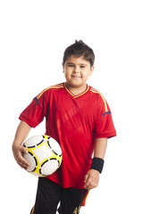 Portrait of a smiling boy holding a soccer ball