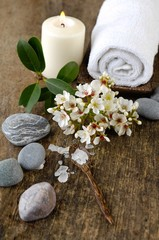 bunch of spring flower, candle, massage oil ,stones,