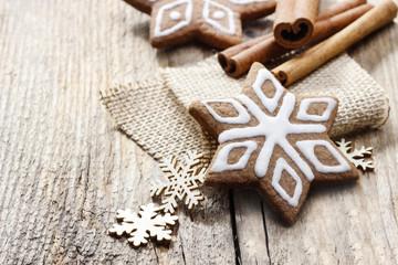 Christmas gingerbread cookies in star shape on rustic wood