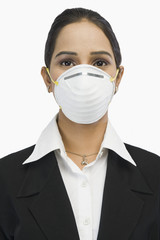 Close-up of a businesswoman wearing an H1N1 mask