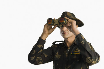 Army soldier looking through binoculars