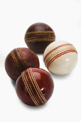 Close-up of old and new cricket balls