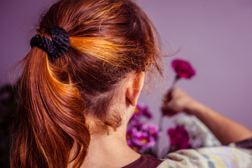 Young woman arranging a bouquet of flowers