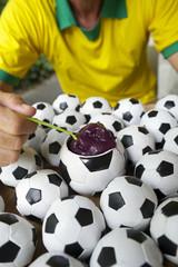 Brazilian Soccer Player Eats Acai with Footballs