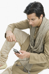 Man text messaging on a mobile phone