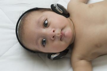 Baby boy listening to headphones