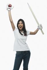 Portrait of a female cricket fan cheering