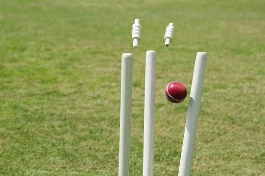 Cricket ball hitting stumps