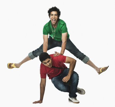 Two university students playing leapfrog