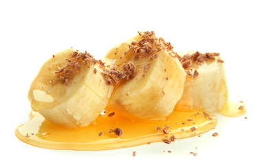 Banana slices with honey, isolated on white