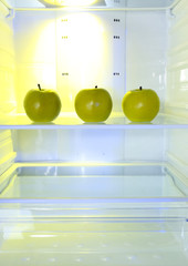 Apples in open empty refrigerator. Weight loss diet concept.