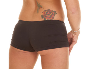 Woman back tattoo shorts