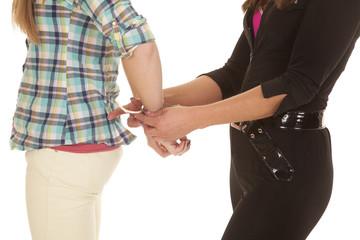 Woman cop handcuff woman close hands