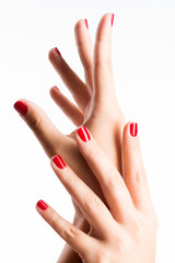 Wall Mural - Closeup photo of a female hands with red nails