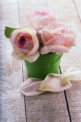 Postcard withpastel roses in little bucket