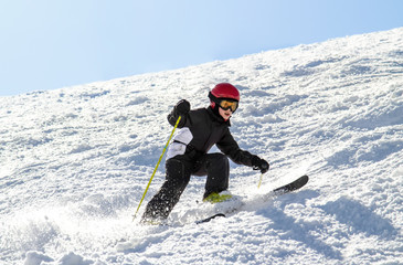 Young skier on an uneven slope