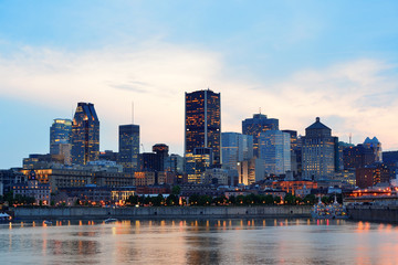 Wall Mural - Montreal over river at sunset