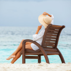 Wall Mural - Pretty woman relaxing on the beach