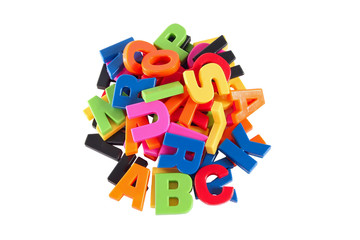 Colorful symbols heap of alphabet. Education concept. Isolated o