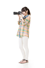 Asian woman takes pictures with photo camera