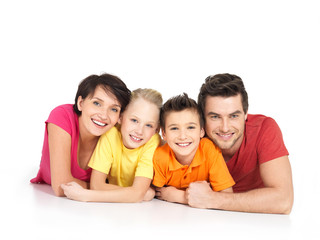 Wall Mural - happy family with two children lying on white floor