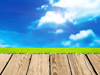 wood floor with cloud sky, grass, stone and background