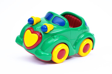 Green toy car, tilted