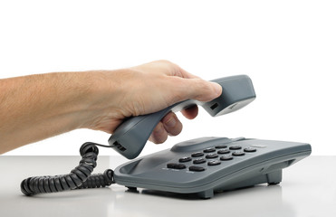 Phone Call: a man's hand hanging the phone receiver