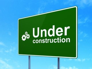 Web design concept: Under Construction and Gears on road sign