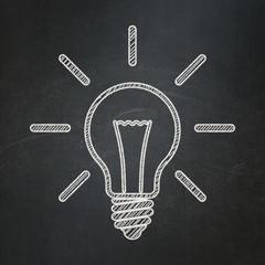Business concept: Light Bulb on chalkboard background