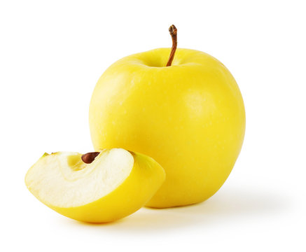 Yellow apple with a slice
