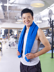 man in gym happy and smiling