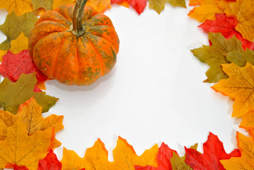Autumn Border of Leaves and a Pumpkin
