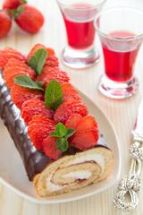 Chocolate swiss roll cake with strawberries