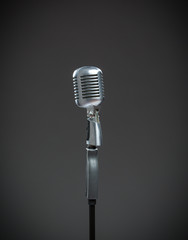 Close up of silver microphone on grey