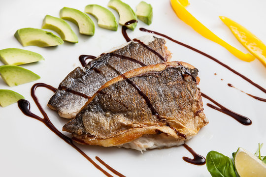 pan seared fillet of white fish, balsamico sauce and vegetables